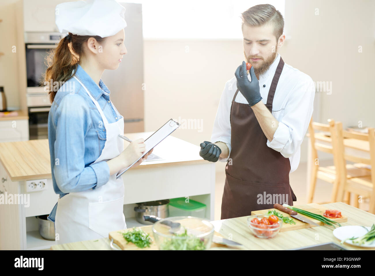 Two Chefs in Restaurant Kitchen - Stock Image