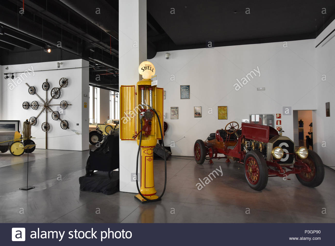 Exhibition room with classic vintage Royal Dutch Shell petrol pump displayed at Museum Of Automobiles (Museo Automovilístico) in Malaga Spain Europe. - Stock Image