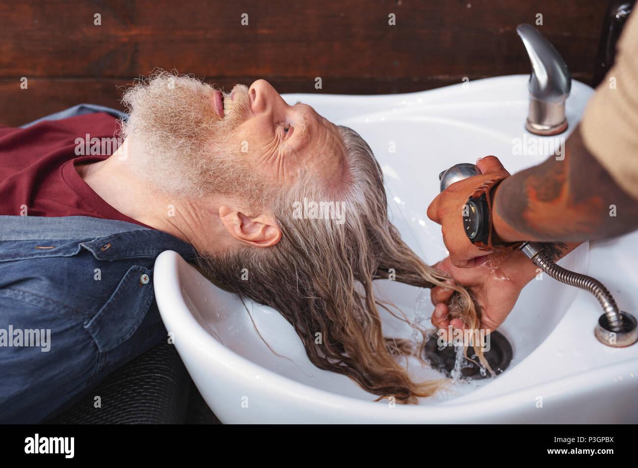 Joyful male person spending weekend with pleasure - Stock Image