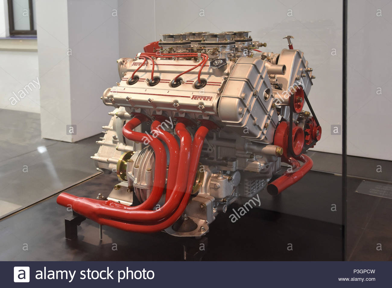 4 cylinder Ferrari engine displayed at Museum Of Automobiles (Museo Automovilístico) in Malaga Spain Europe. - Stock Image