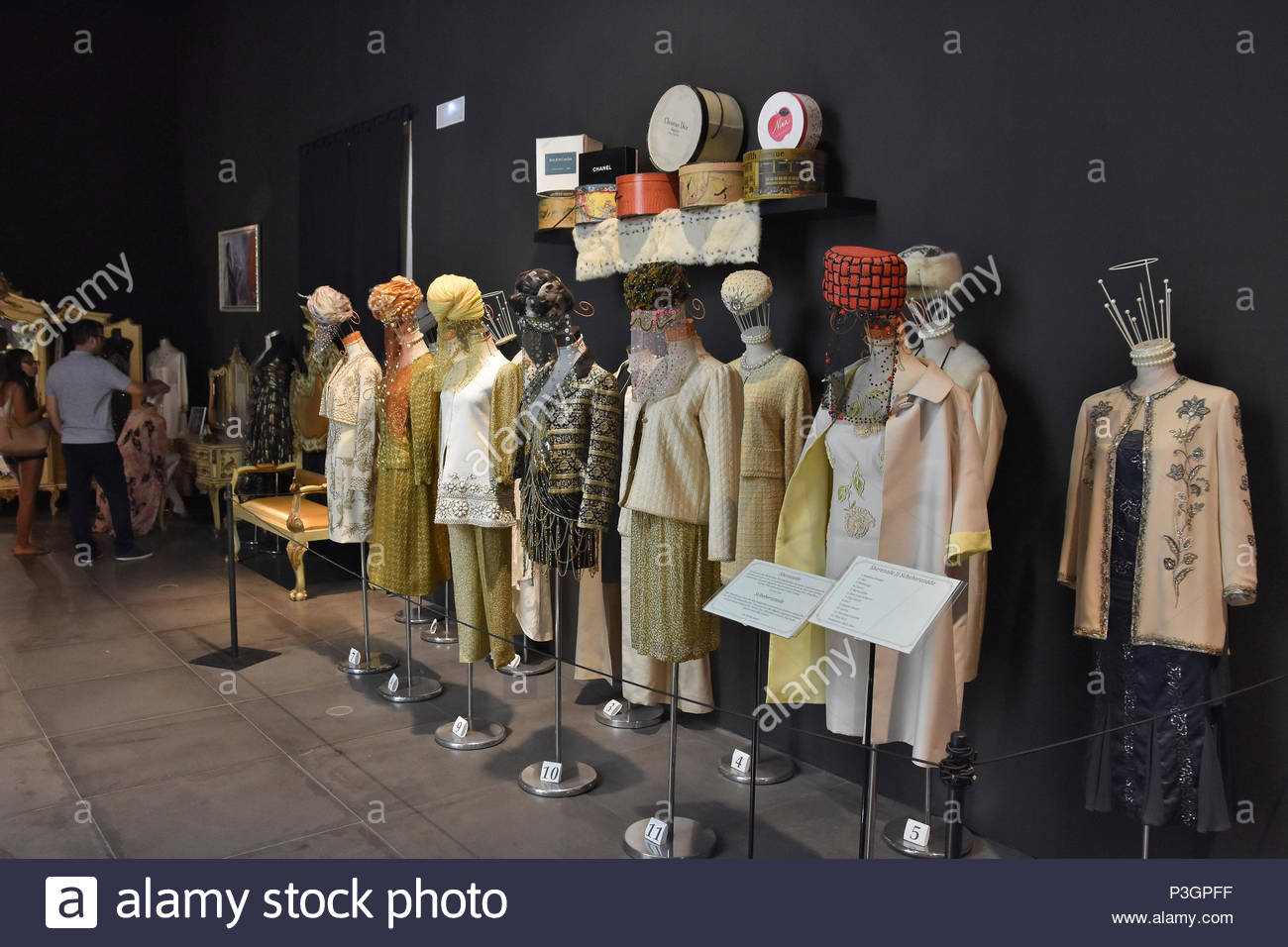 Figures wearing dresses from famous fashion designers, one of the Haute Couture collections displayed at Automobile and Fashion Museum in Malaga Spain - Stock Image