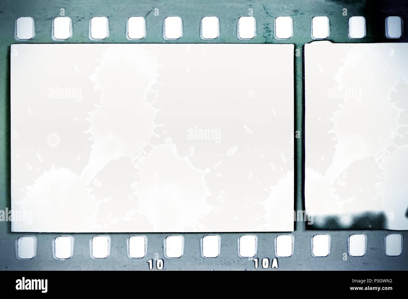 Vintage film strip frame on old and damaged paper background. Blue ...