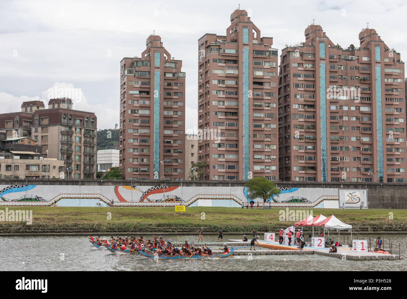 Taipei, Taiwan, 18 June: Dragon boats teams pass participate in the