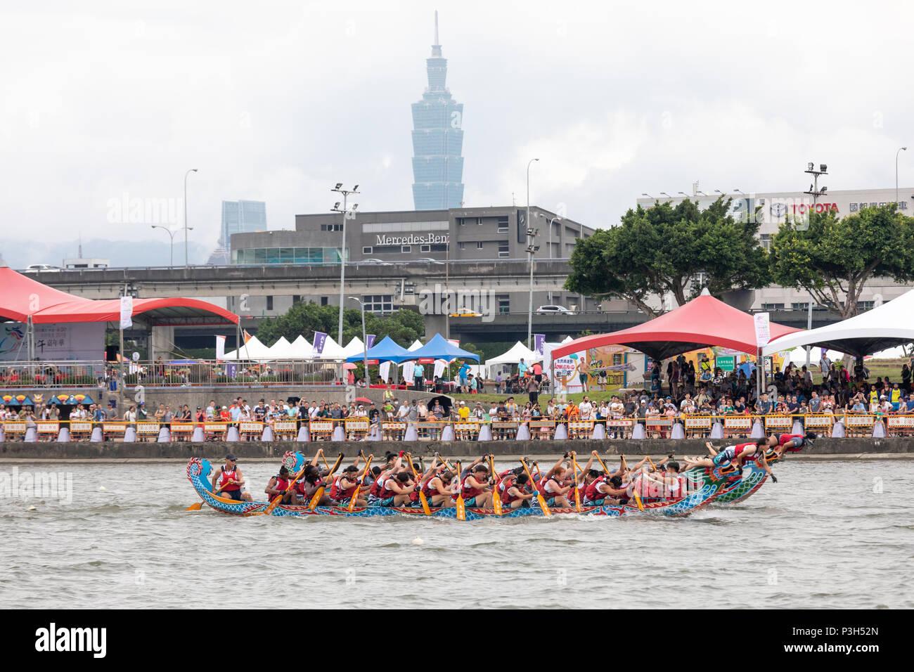 Taipei, Taiwan, 18 June: Dragon boats pass below Taipei 101 during