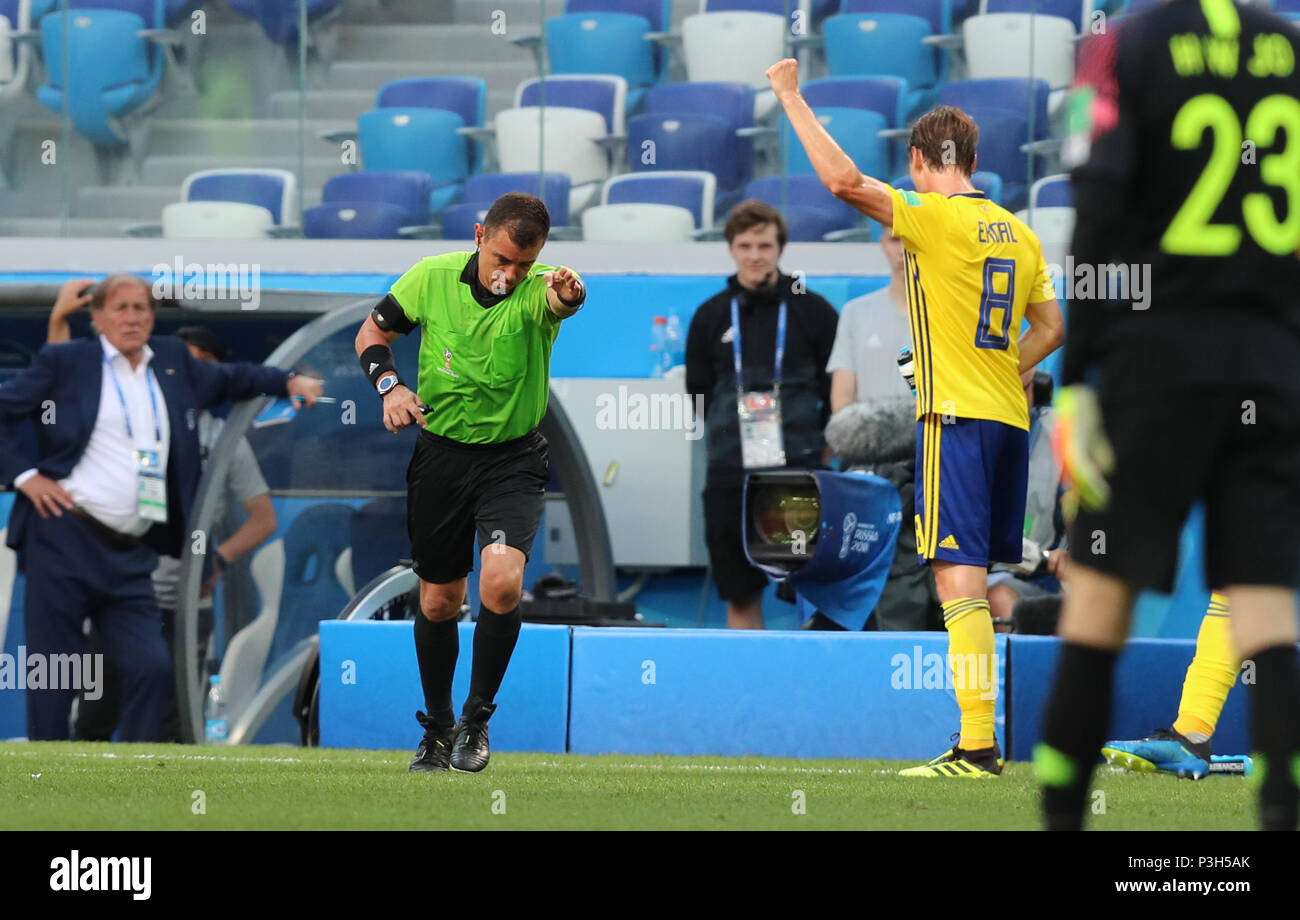 Referee (L front) awards Sweden a penalty after Video Assistant Referee  (VAR) review during a group F match between Sweden and South Korea at the 2018  FIFA ... 45e06d5b9