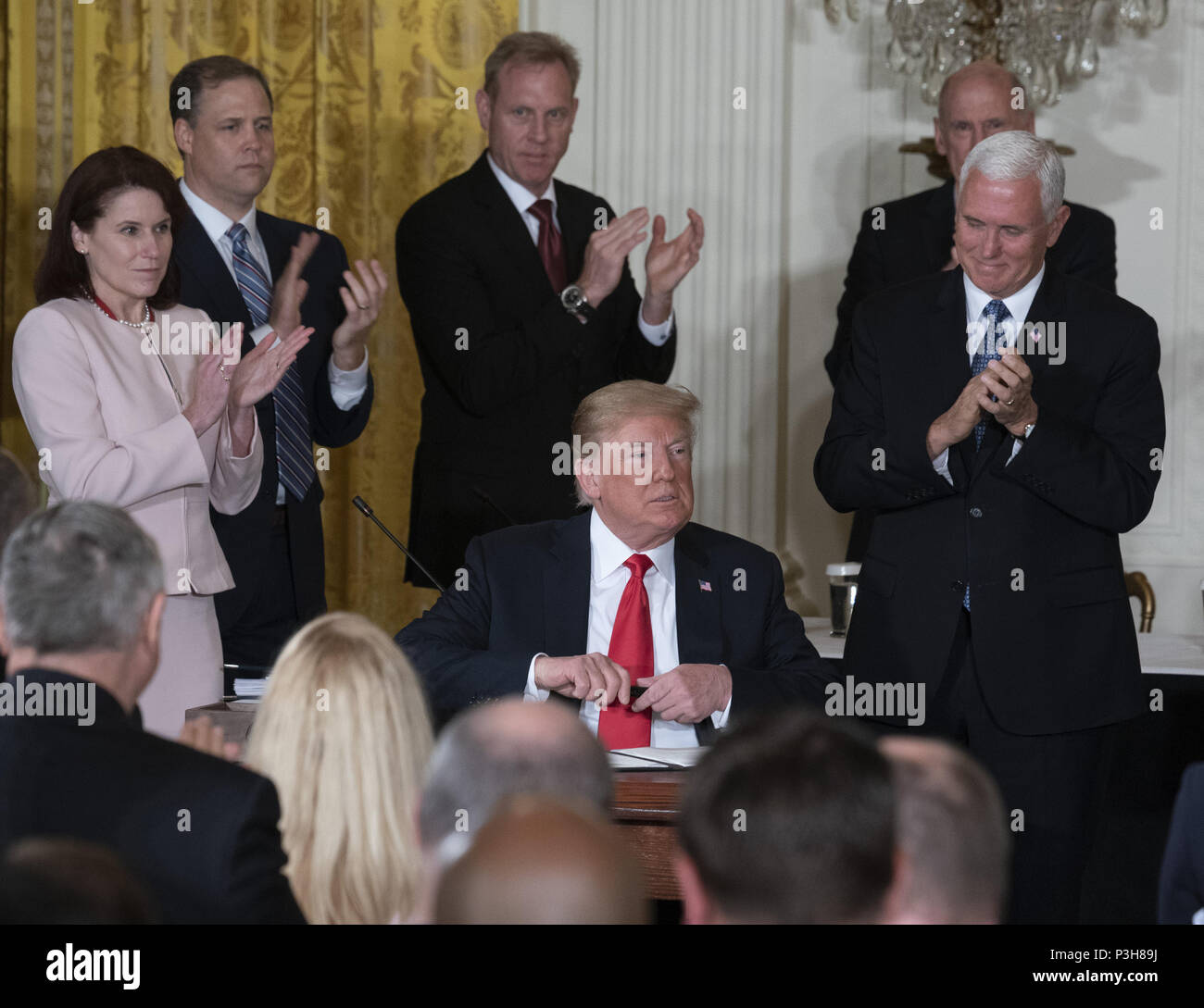 Washington, District of Columbia, USA. 18th June, 2018. United States President Donald J. Trump signs Space Policy Directive 3 during a meeting of the National Space Council at The White House in Washington, DC, June 18, 2018. The directive addresses issues including monitoring of objects in orbit, providing that information to spacecraft operators to avoid collisions, and to limit the growth of orbital debris. Chris Kleponis/CNP Credit: Chris Kleponis/CNP/ZUMA Wire/Alamy Live News - Stock Image