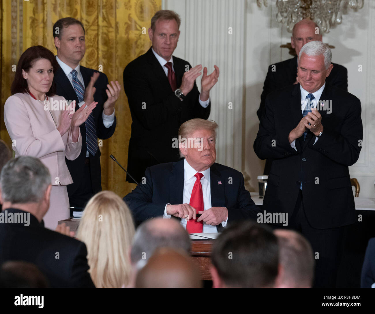 United States President Donald J. Trump signs Space Policy Directive 3 during a meeting of the National Space Council at The White House in Washington, DC, June 18, 2018. The directive addresses issues including monitoring of objects in orbit, providing that information to spacecraft operators to avoid collisions, and to limit the growth of orbital debris. Chris Kleponis/CNP | usage worldwide - Stock Image