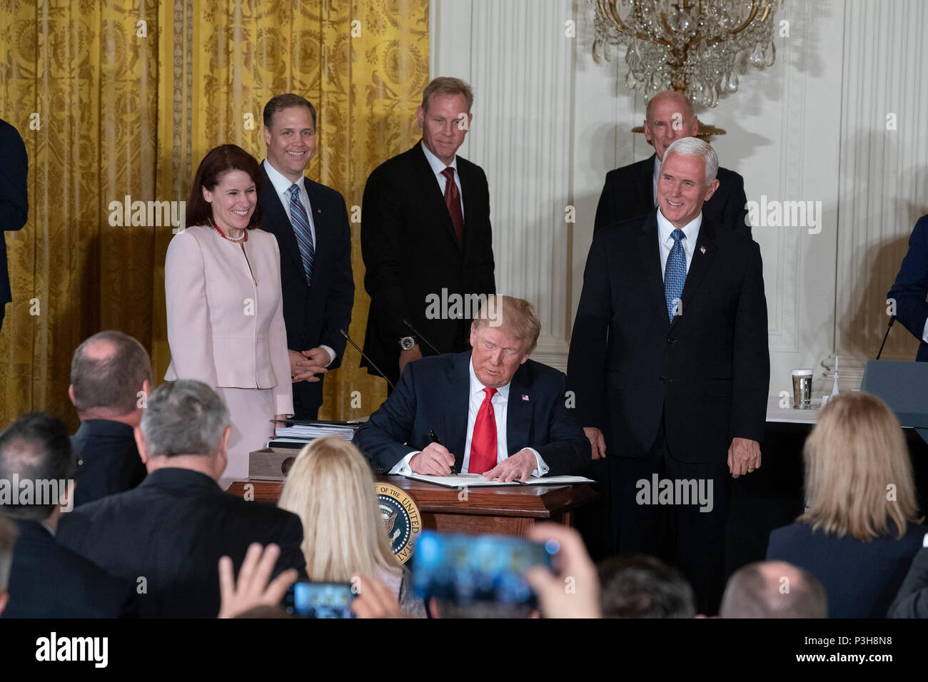 United States President Donald J. Trump signs Space Policy Directive 3 during a meeting of the National Space Council at The White House in Washington, DC, June 18, 2018. The directive addresses issues including monitoring of objects in orbit, providing that information to spacecraft operators to avoid collisions, and to limit the growth of orbital debris. Chris Kleponis/CNP /MediaPunch - Stock Image