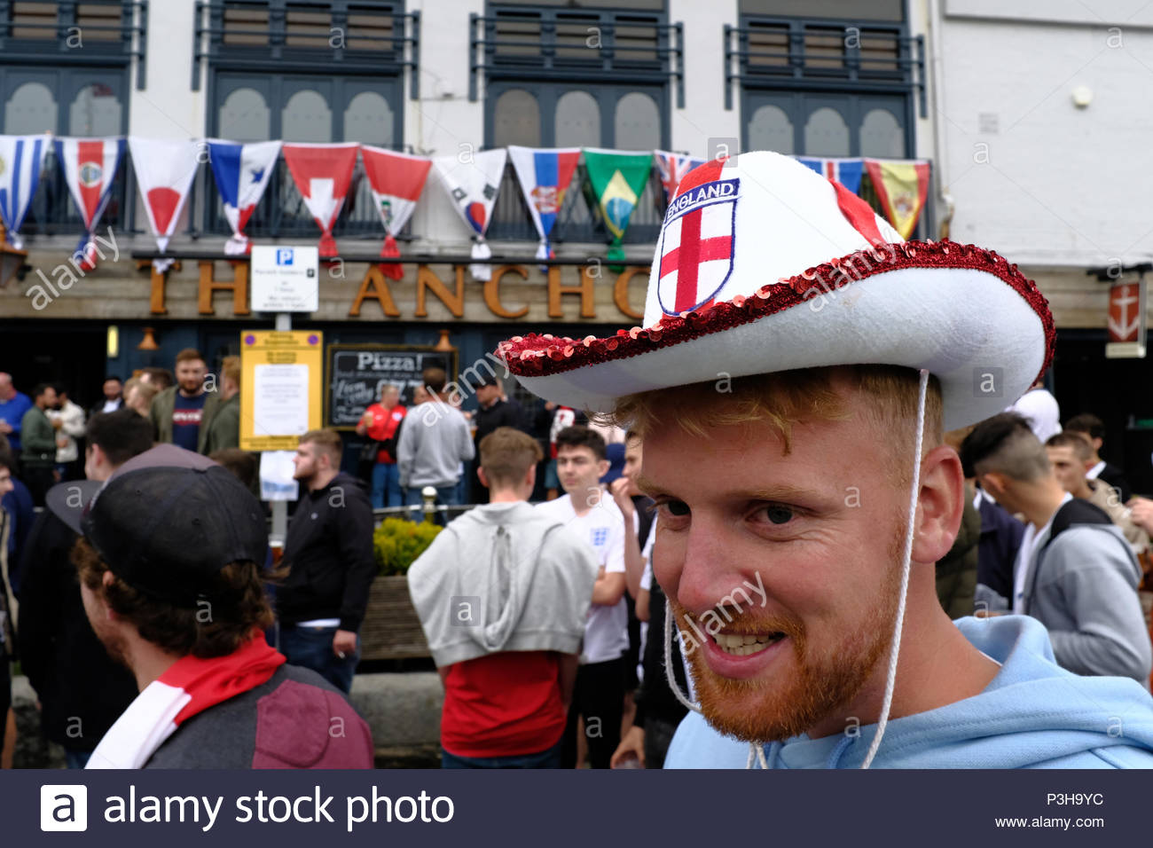 Weymouth, UK. 18th June, 2018. World Cup England supporter with England Cowboy Hat at outdoor screening at Weymouth quayside. Credit: SI JUBB/Alamy Live News - Stock Image