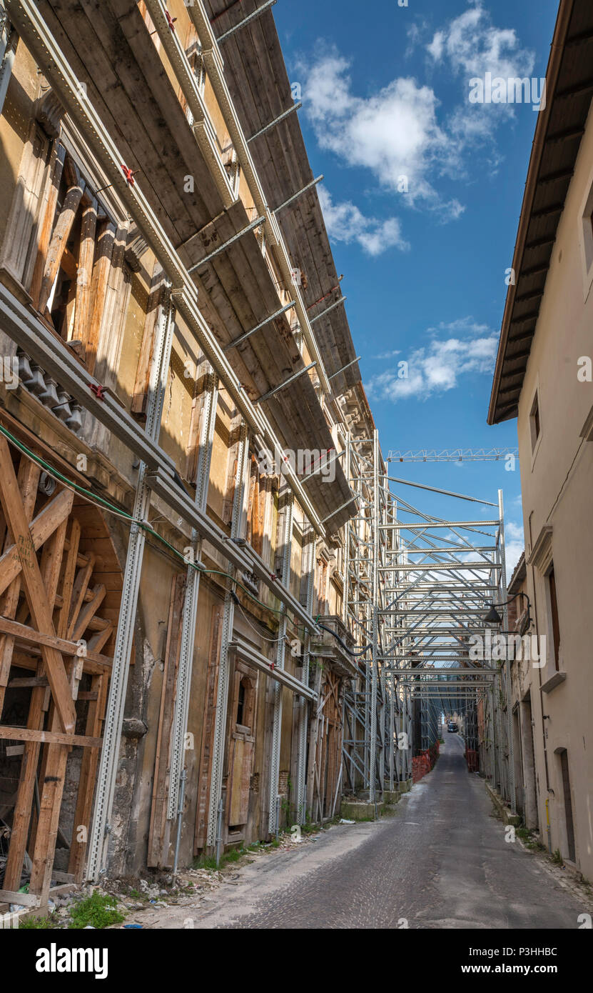 Buildings damaged in 2009 L'Aquila Earthquake, protected by metal beams, scaffolding, 2018 view, at Via Sassa in L'Aquila, Abruzzo, Italy - Stock Image