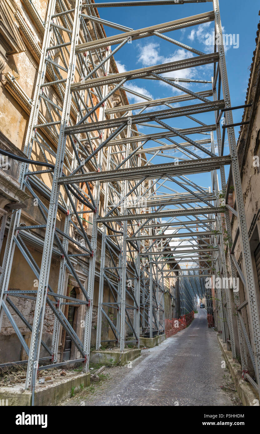 Monastero dell'Eucarestia buildings damaged in 2009 L'Aquila Earthquake, protected by metal beams, scaffolding, 2018 view, in L'Aquila, Abruzzo, Italy - Stock Image