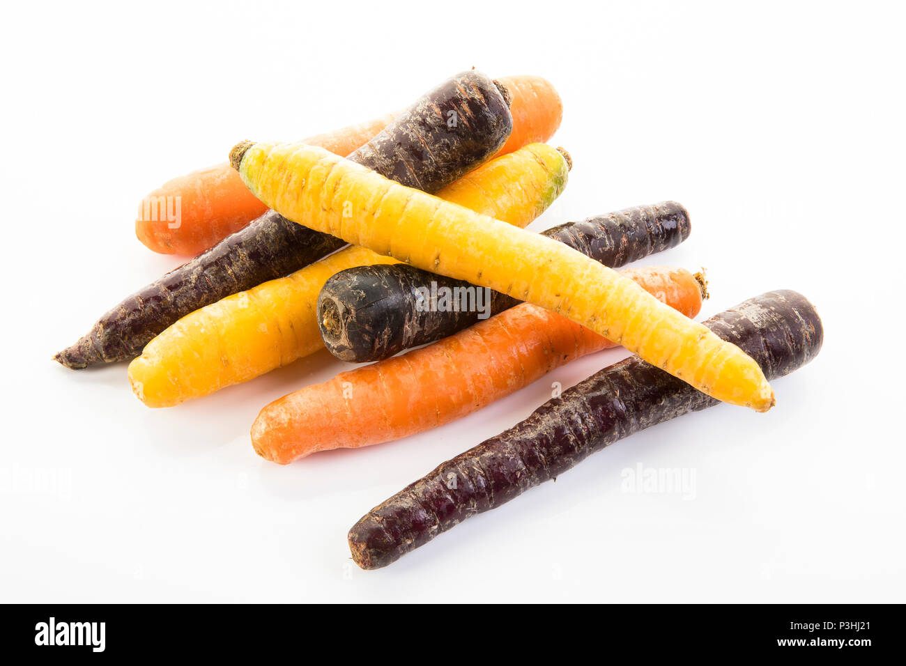 Karotten-Mix, orange, creme und violett farbene Karotten Stock Photo