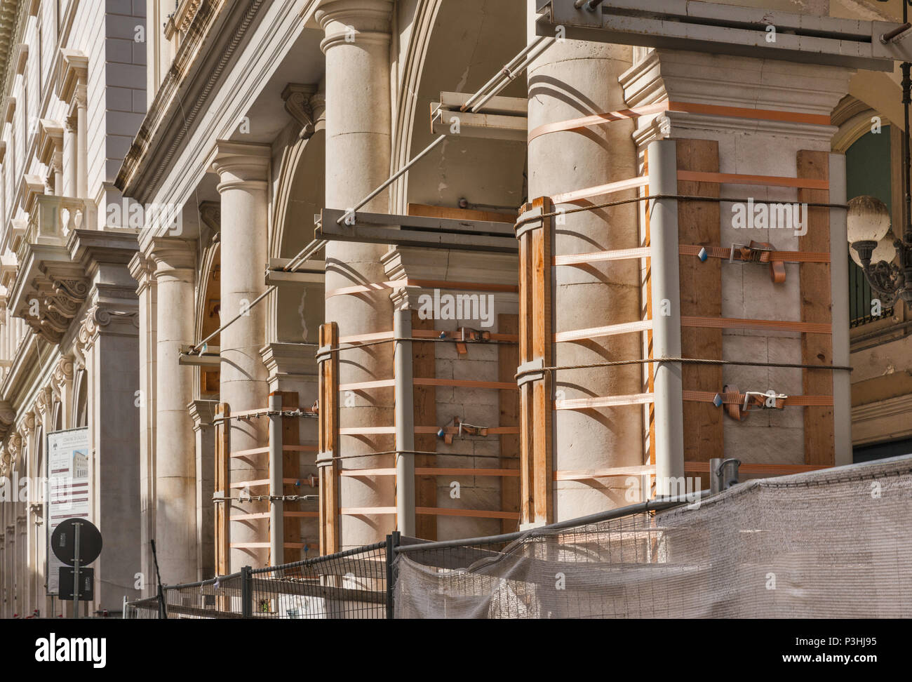 Band clamps protecting Chamber of Commerce, building damaged in 2009 L'Aquila Earthquake, 2018 view, historic center of L'Aquila, Abruzzo, Italy - Stock Image