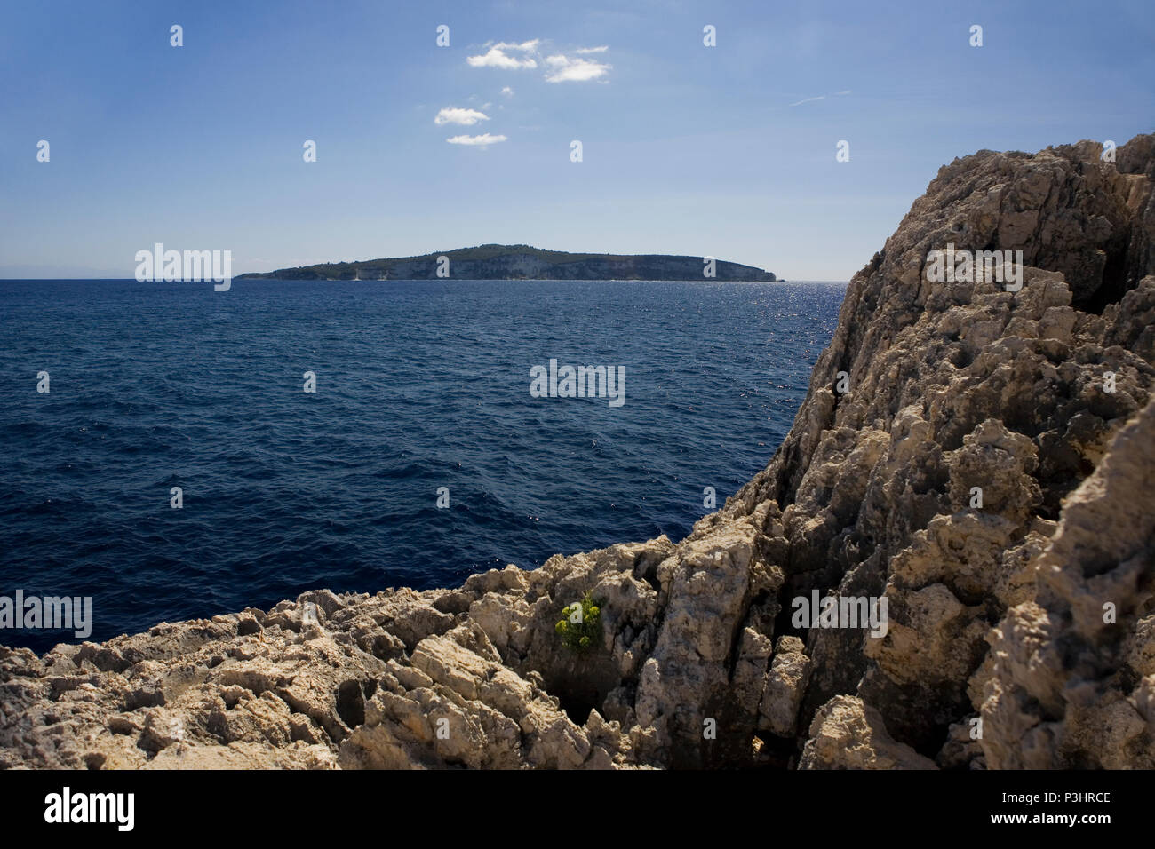Looking south from Moggonissi, at the southern tip of Paxos to the island of Antipaxos, Greece - Stock Image