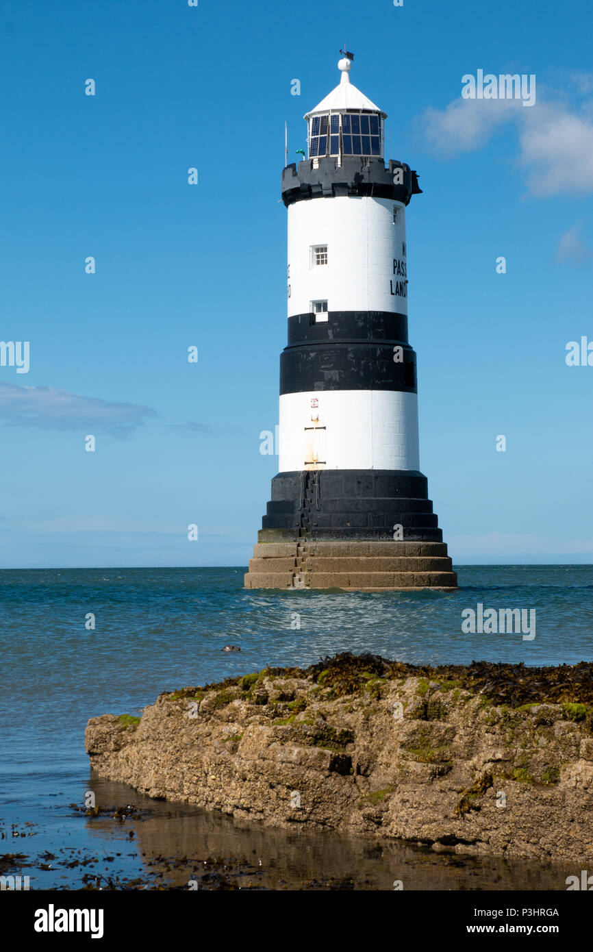 Trwyn Du Lighthouse is a lighthouse between Black Point near Penmon and Ynys Seriol, or Puffin Island, at the eastern extremity of Anglesey, marking t Stock Photo