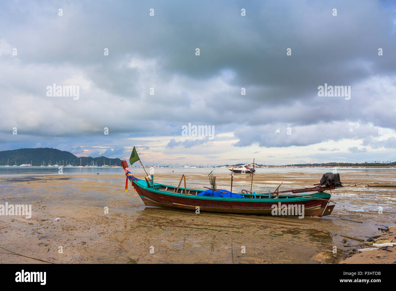 the old ship wreck stuck on the mud near Chalong gulf Stock Photo