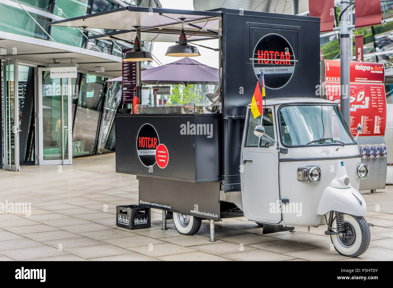 Piaggio Ape Classic 400 platform truck, converted into a rolling sales stand for streetfood with curry sausage, hamburgers, French Fries and Fritz-Kol - Stock Image