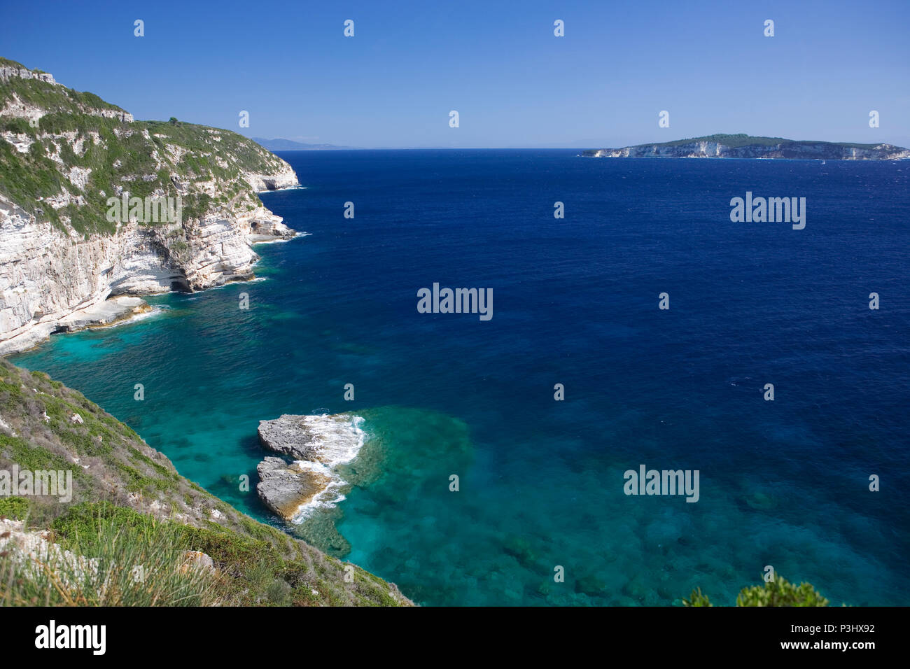 Looking south from the southern end of Paxos to the island of Antipaxos, Greece - Stock Image