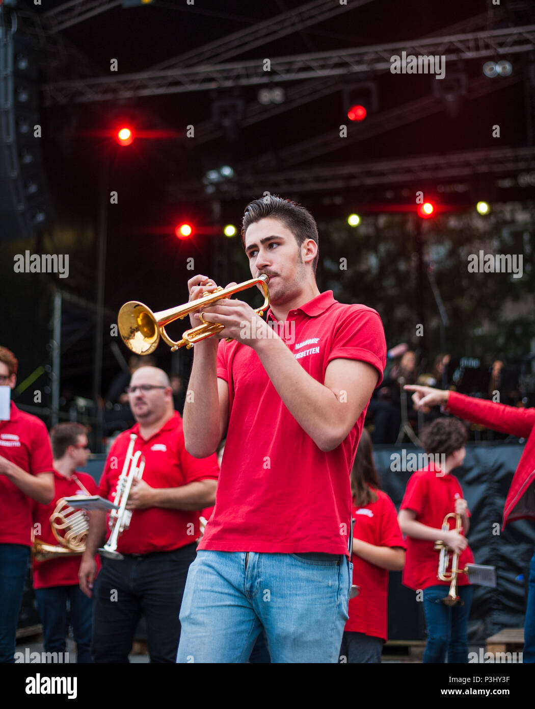 Young musician performing trumpet performance at music festival (Fete de la musique), Luxembourg - Stock Image