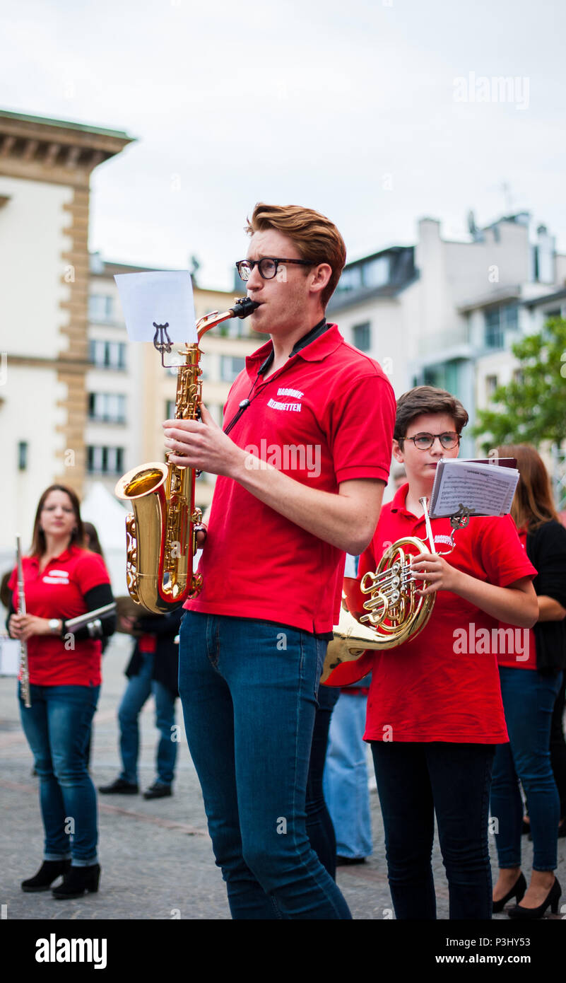 Young musician performing saxophone performance at music festival (Fete de la musique), Luxembourg - Stock Image