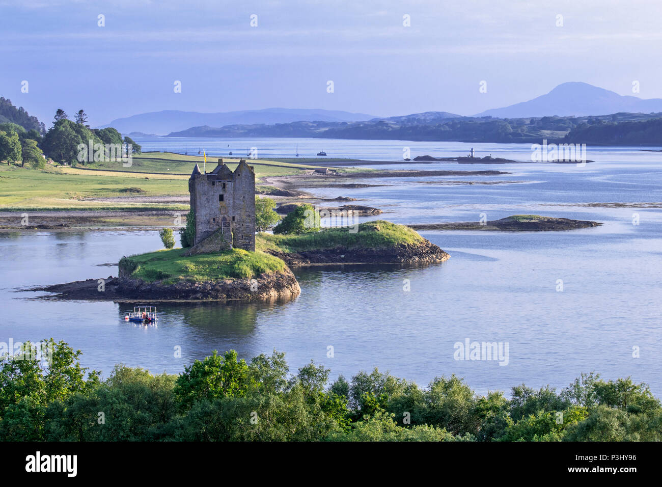 Castle Stalker, medieval four-story tower house / keep in Loch Laich, inlet off Loch Linnhe near Port Appin, Argyll, Scotland, UK - Stock Image