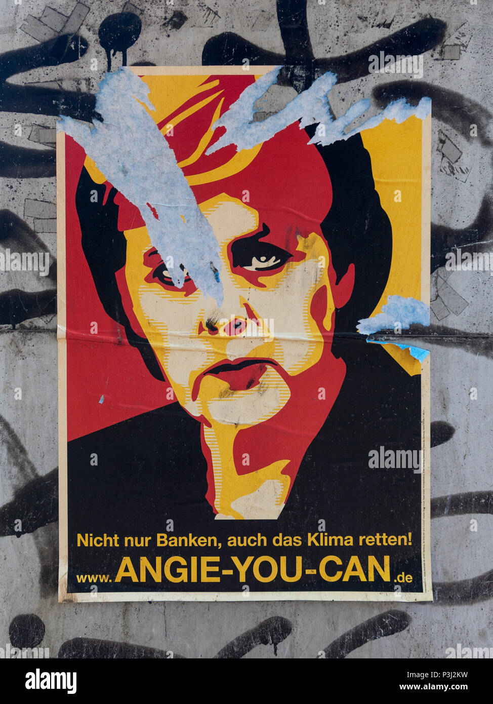 Berlin. Germany. Graphic arts poster portrait of German Chancellor Angela Merkel with the slogan 'Angie You Can'. - Stock Image