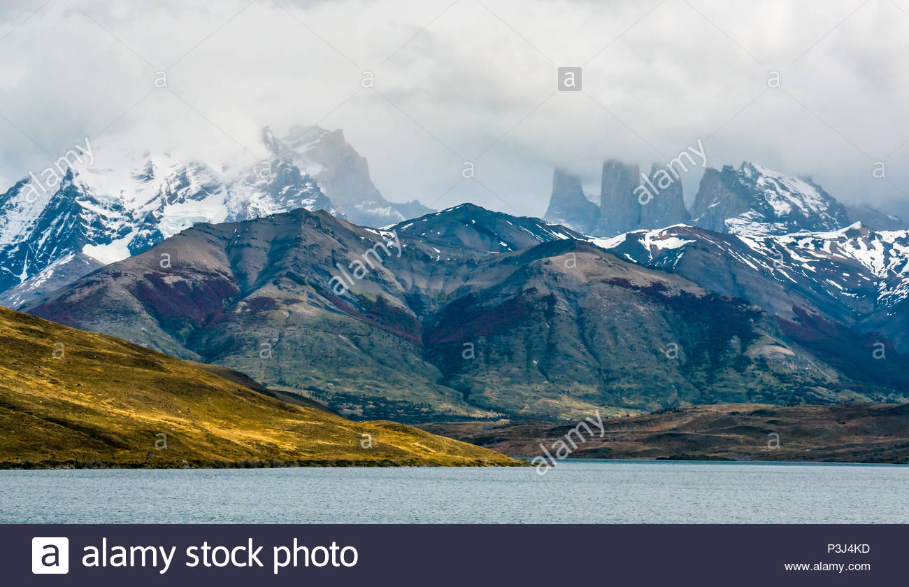 Lake in front of granite Towers of Paine shrouded in cloud, Torres del Paine National Park, Patagonia, Chile, South America - Stock Image
