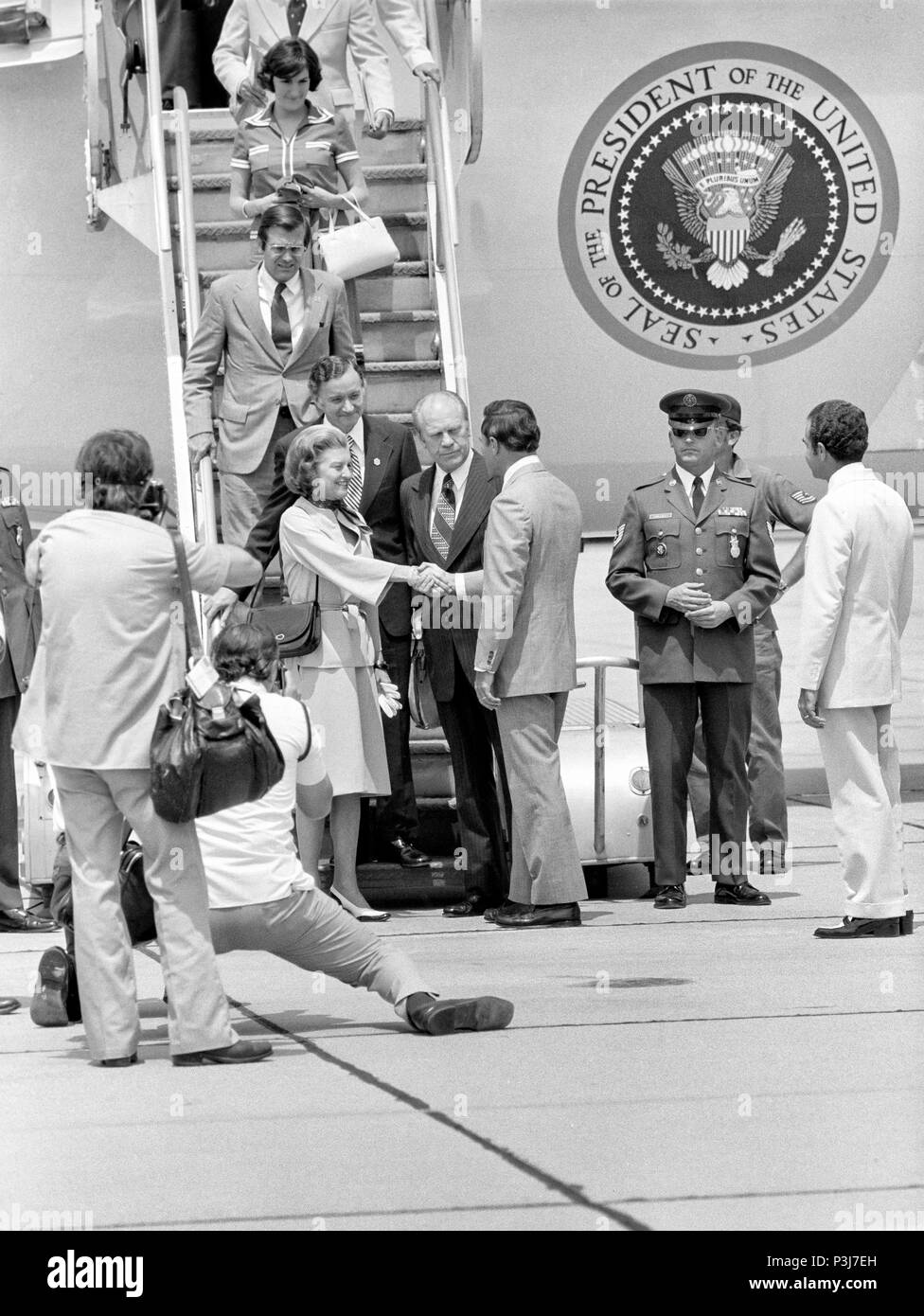 FORT SMITH, AR, USA - AUGUST 10, 1975 -- Arkansas Governor David Pryor greets President and Mrs. Gerald Ford as they arrive to tour a Vietnamese refugee center recently opened in adjacent Fort Chaffee.  Fort Chaffee was converted to a refugee center to help handle the flood of refugees that occurred after South Vietnam fell to the North at the end of the Vietnam War. - Stock Image