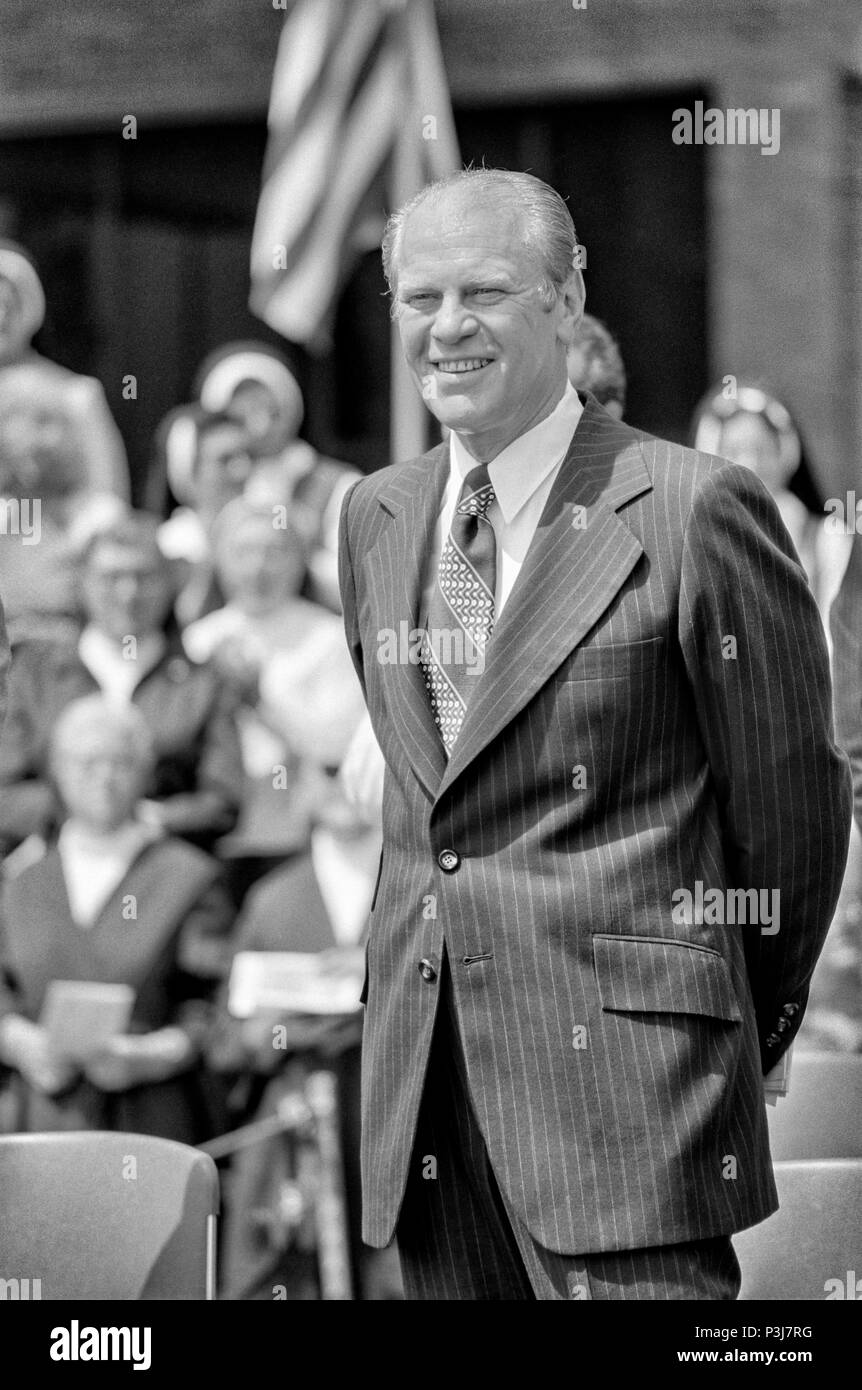 FORT SMITH, AR, USA - AUGUST 10, 1975 -- President Gerald R. Ford waits to speak as he is being introduced before a crowd of thousands of South Vietnamese refugees recently evacuated from their country as it fell to North Vietnamese forces. - Stock Image