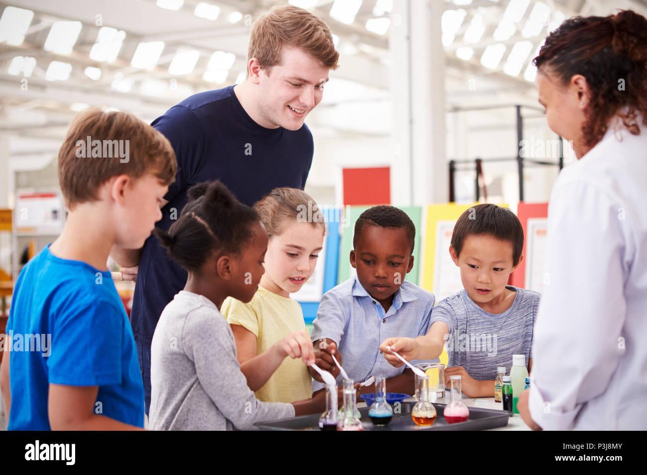 School kids taking part in a science experiment, close up - Stock Image