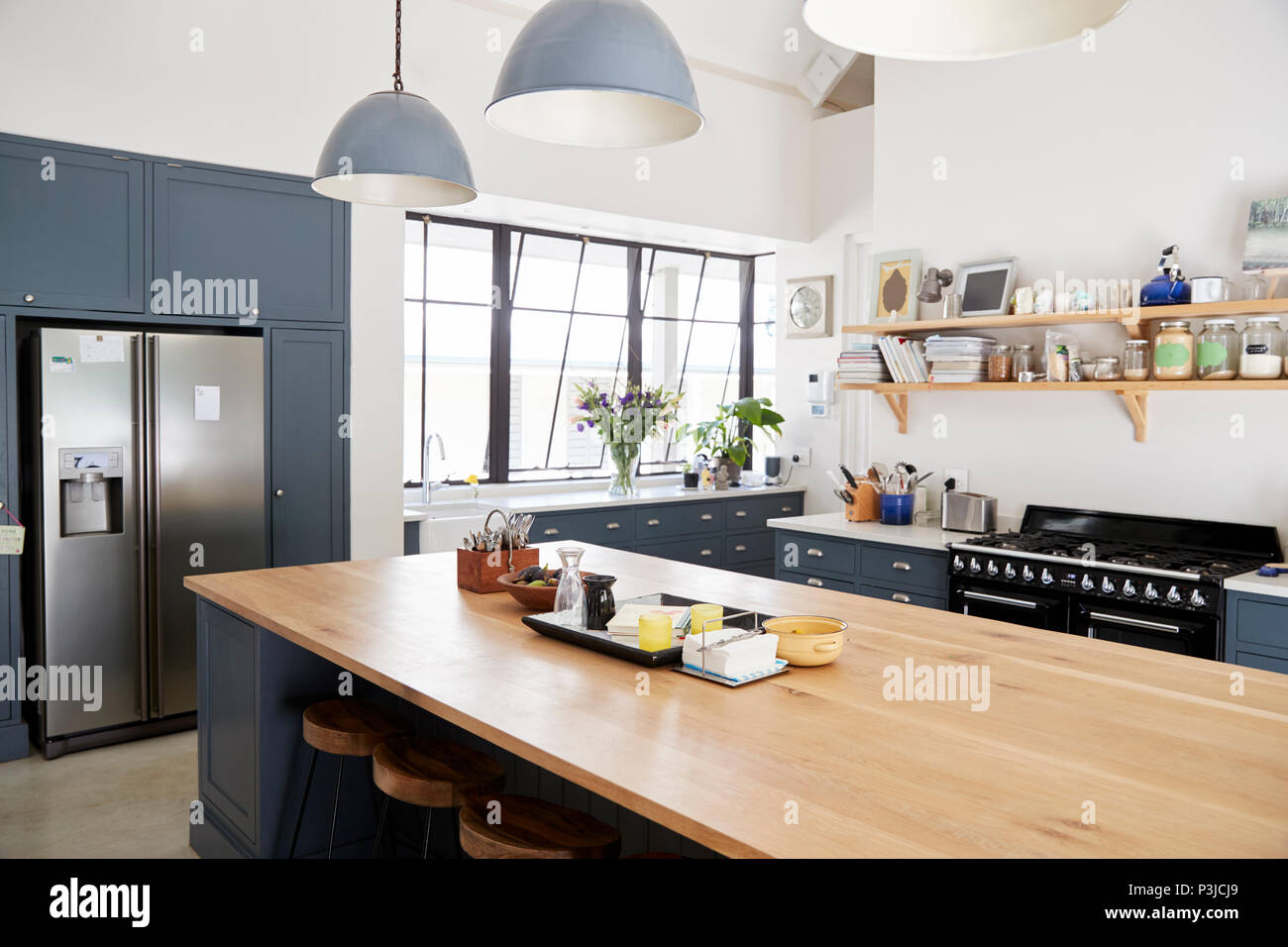 Kitchen Island In A Large Family Kitchen Stock Photo Alamy