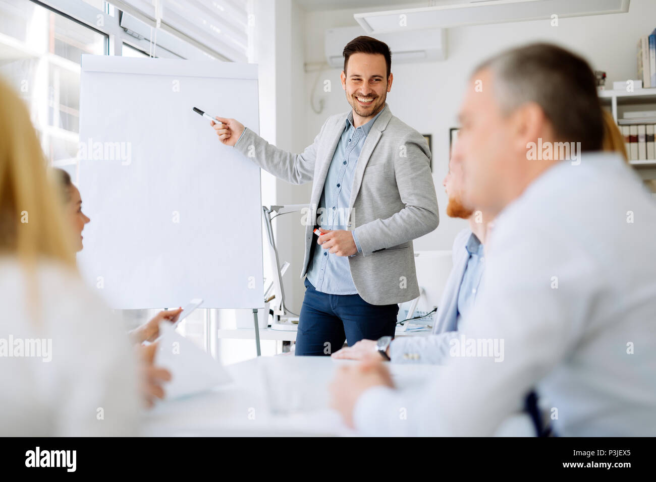 Presentation and collaboration by business people - Stock Image