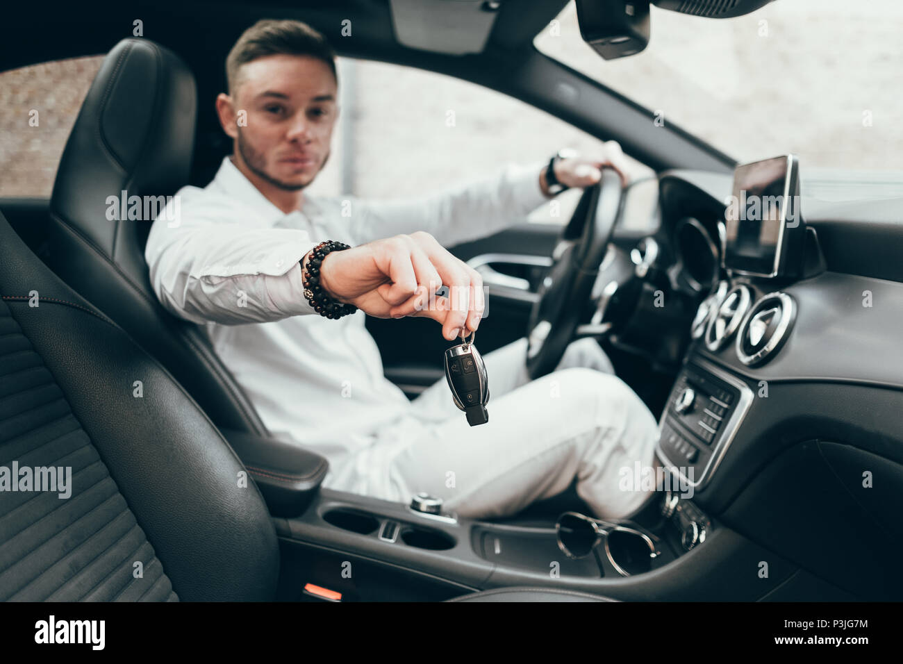 Handsome Young Man Showing Car Keys In His Newly Bought Auto Sitting
