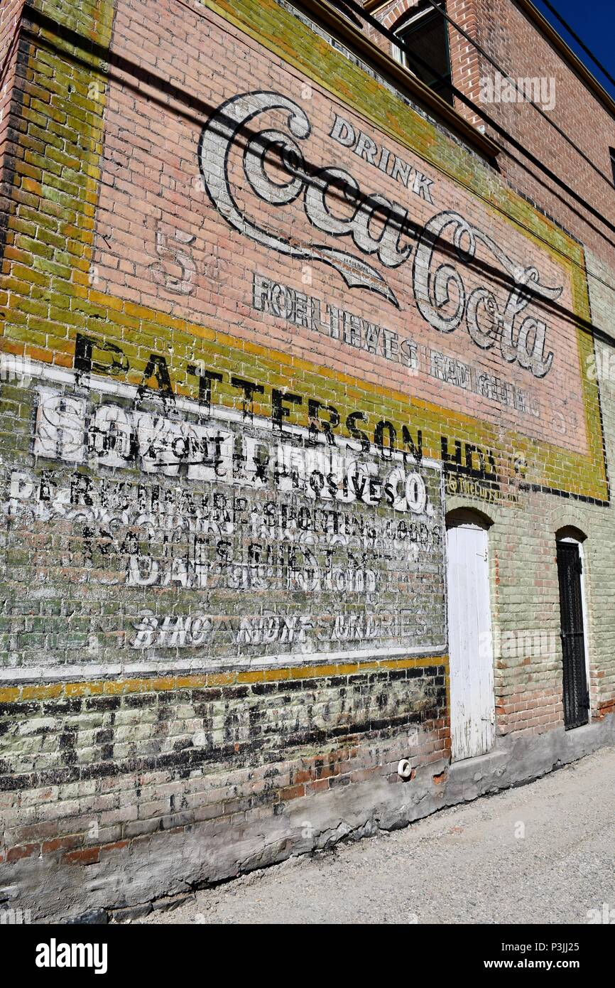 Layers of old painted advertisements in Salida - Stock Image