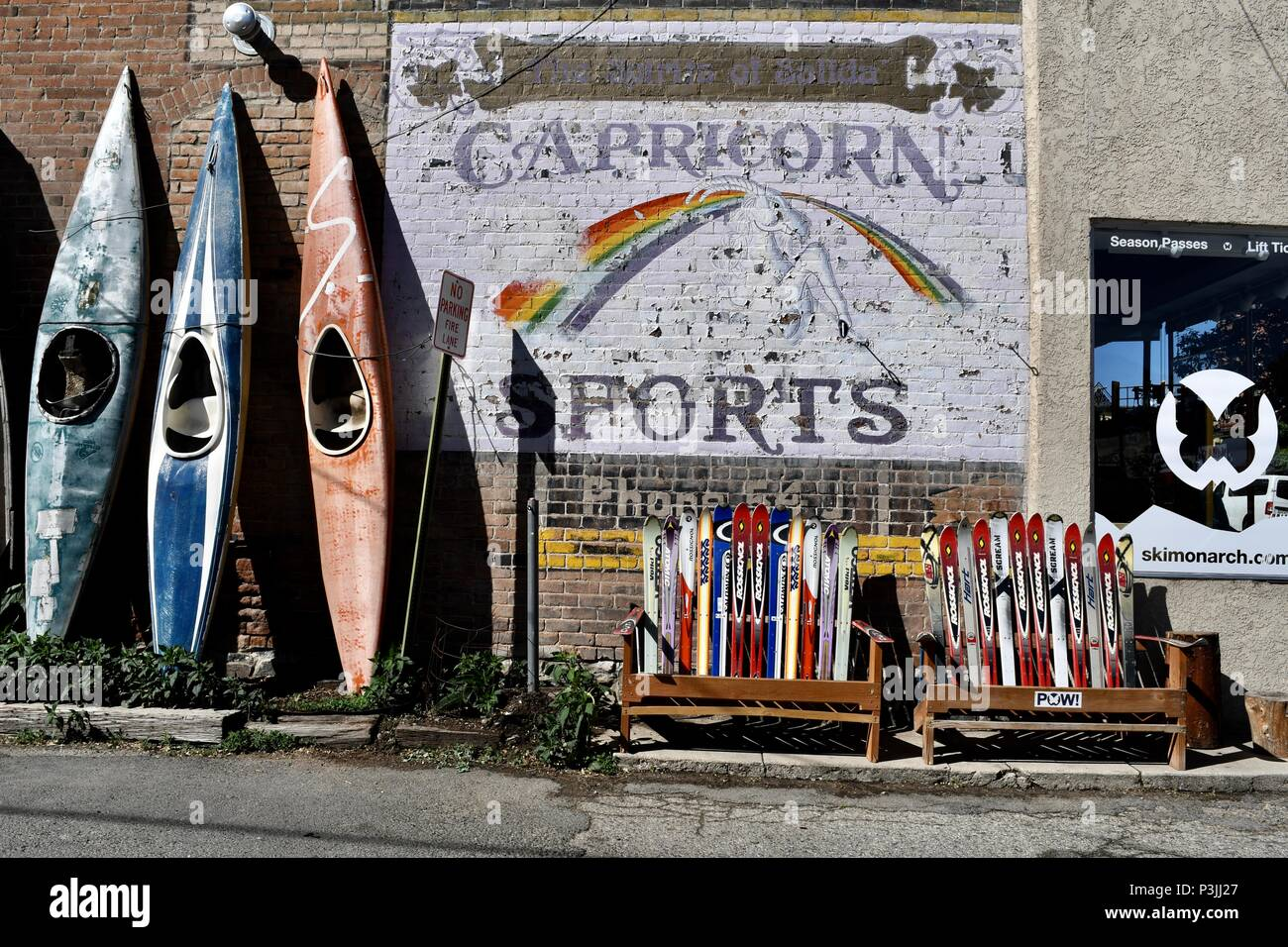 Painted wall advertisement in Salida, advertising Capricorn Sports - Stock Image