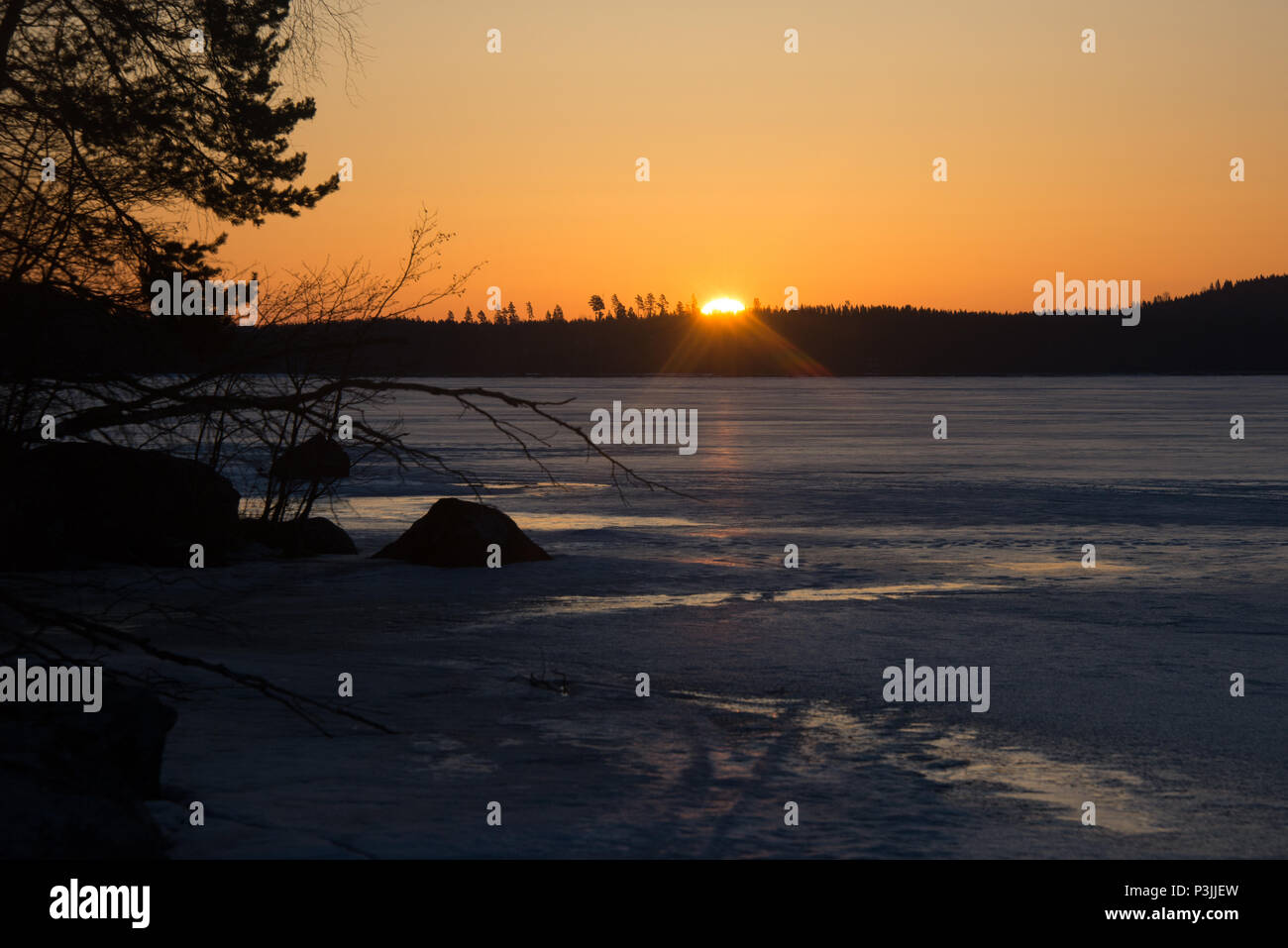 Lake Kukkia Sunrise. Luopioinen, FInland. 11.4.2018. I forgot my Nikon D610 while taking photos of the sunset last evening. So I got up early to witne - Stock Image