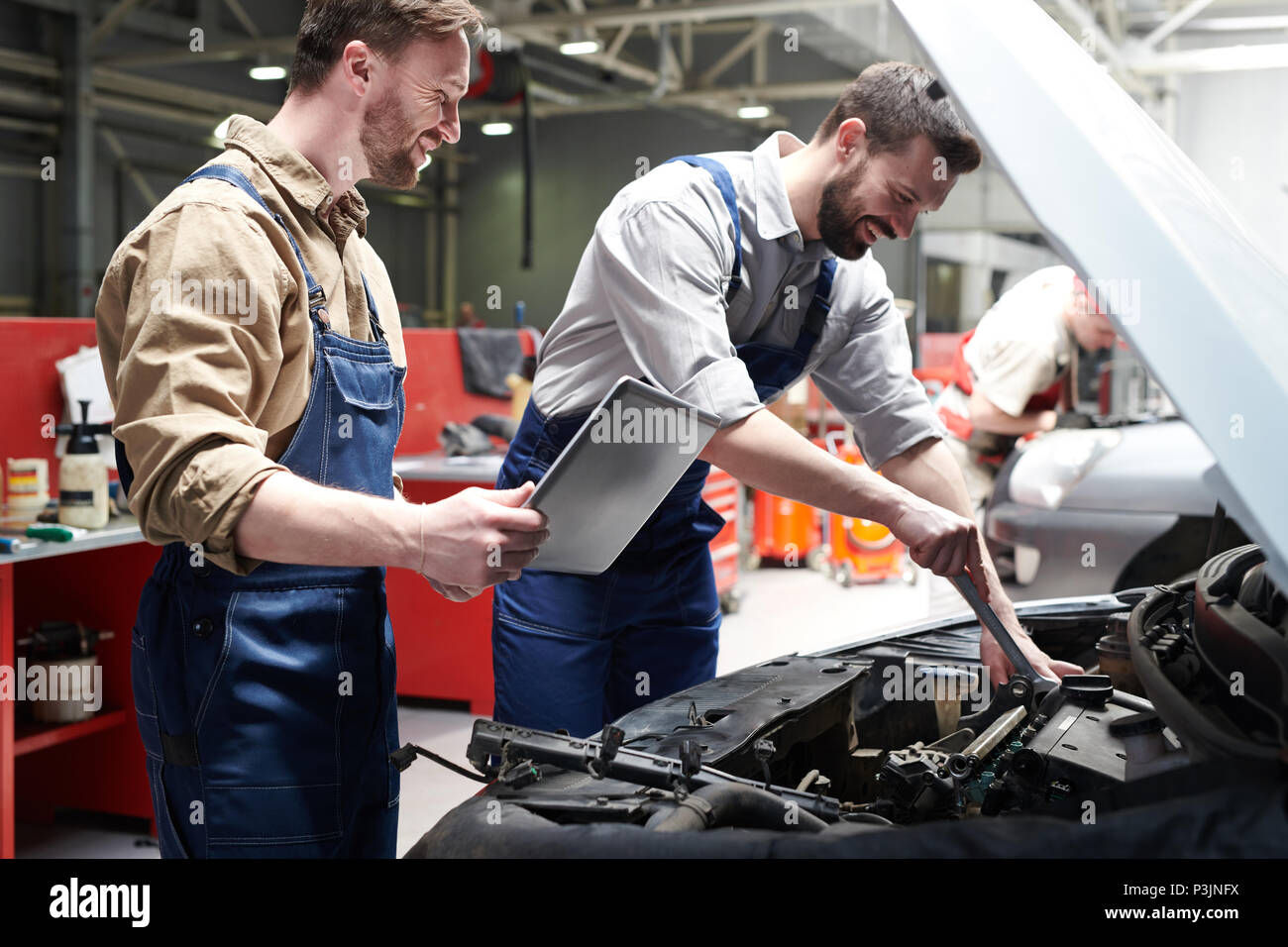 Workers Checking Car in Service - Stock Image