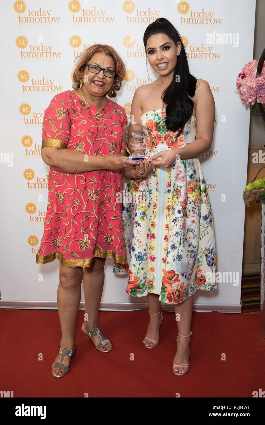 Cara de la Hoyde collects award from Charity 'Today and Tomorrow' for Inspirational Mother of the Year. Nathan Massey attended the event to support her  Featuring: Janet Ginnings, Cara de la Hoyde Where: London, United Kingdom When: 18 May 2018 Credit: Phil Lewis/WENN.com - Stock Image