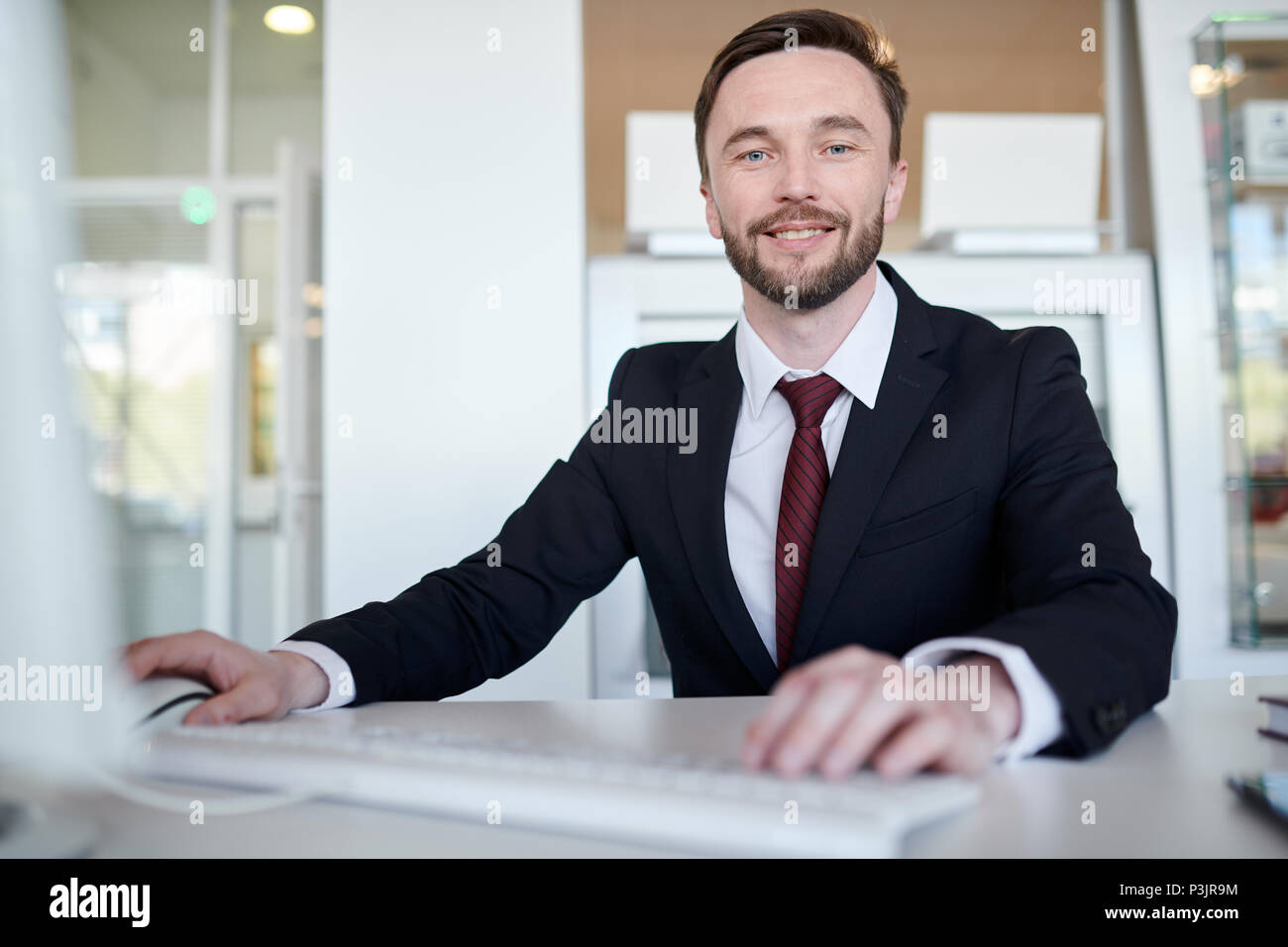 Handsome Business Manager At Desk Stock Photo Alamy