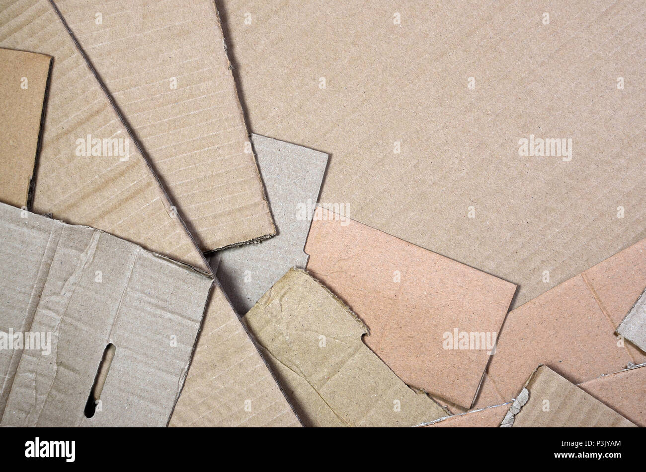 Background of paper textures piled ready to recycle. A pack of old office cardboard for recycling of waste paper. Pile of wastepaper - Stock Image