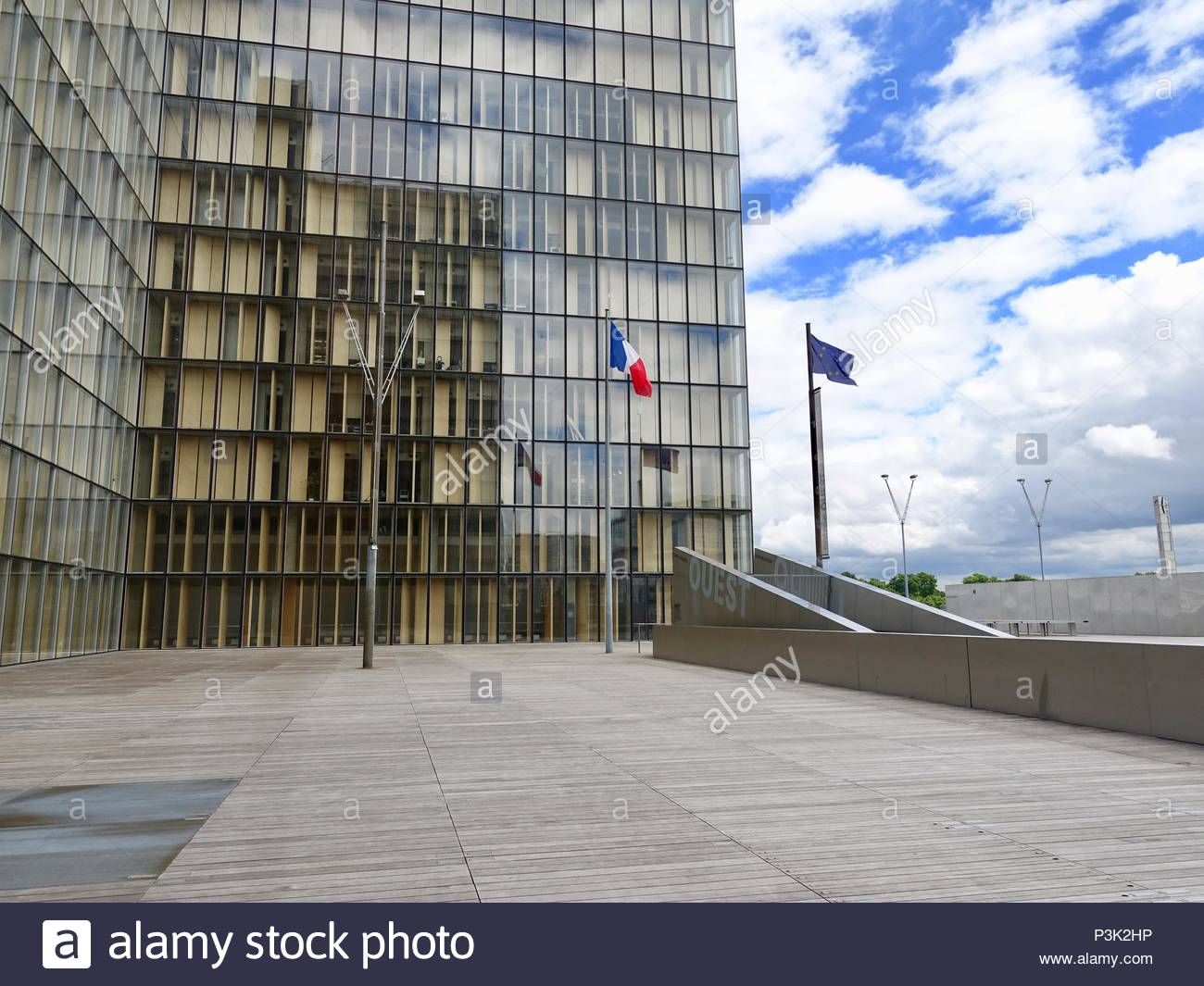 Closeup view of a section of the National Library of France, Bibliotèque National de France, with French and European Union flags, Paris, France - Stock Image