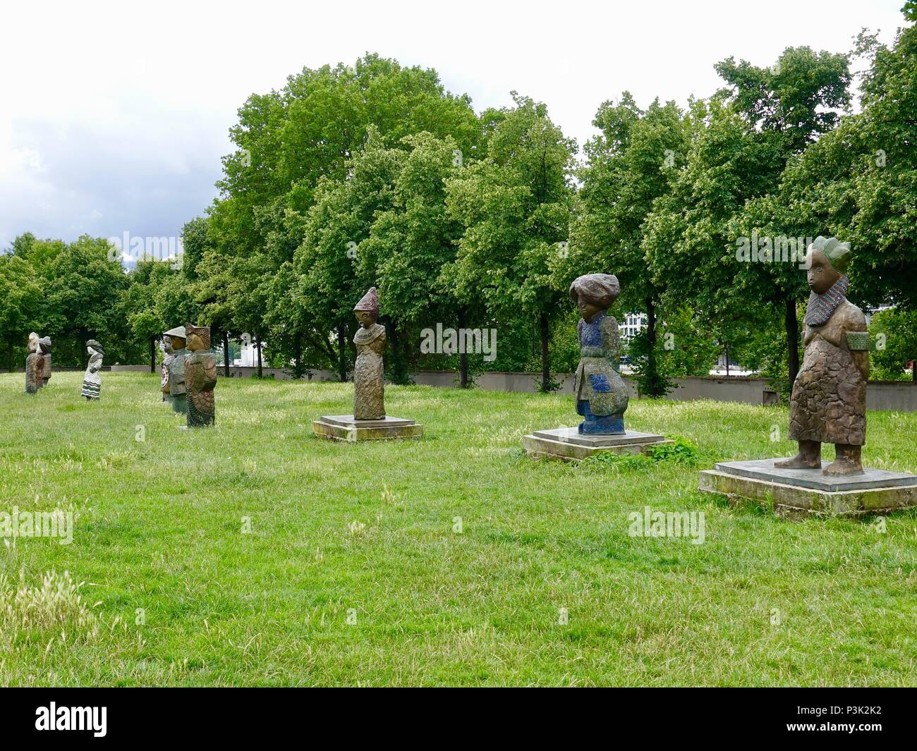 Some of the statues of the work, 'Children of the World,' public art by artist Rachid Khimoune, Bercy Park, Paris, France - Stock Image