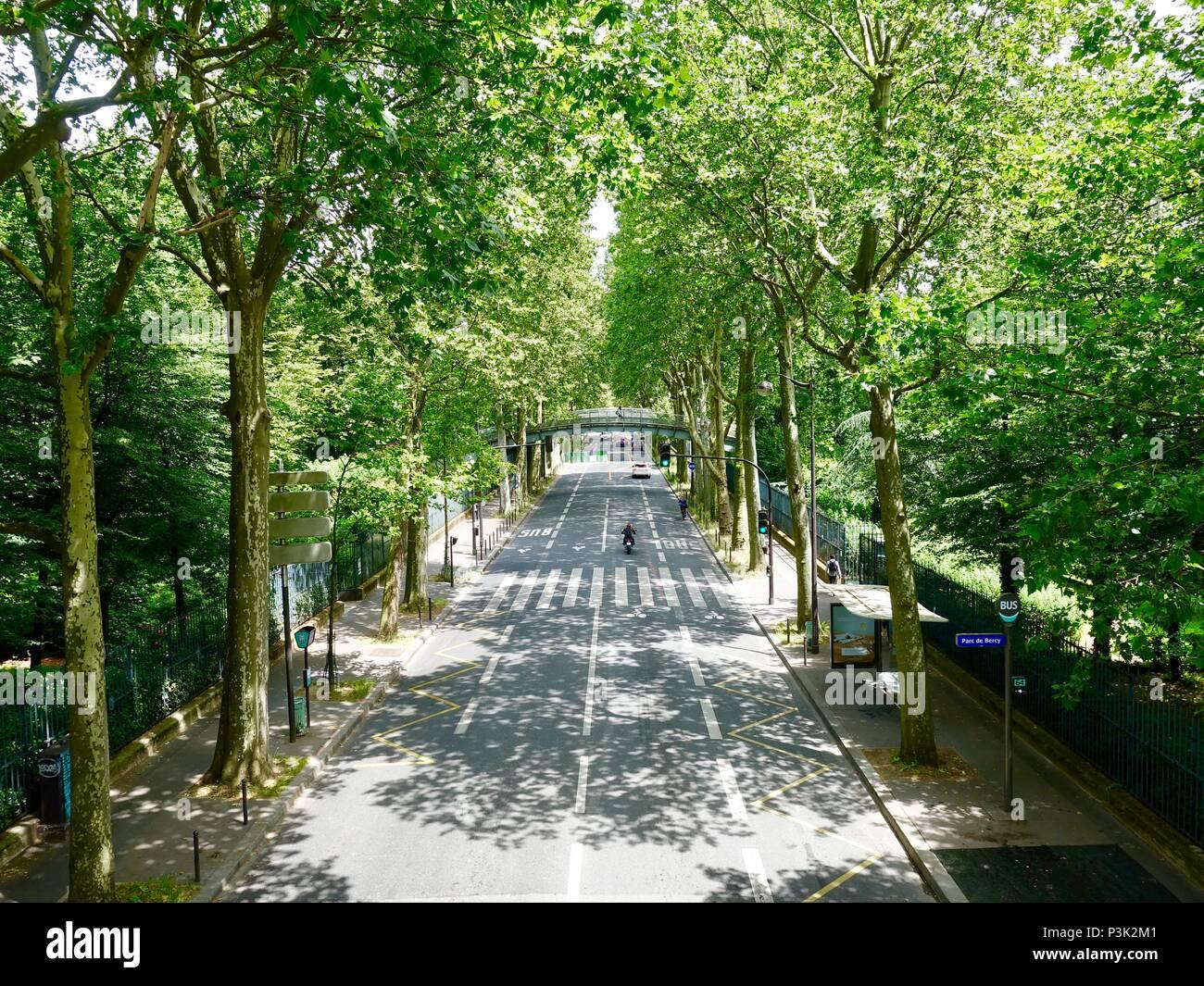 Rue Joseph Keseel, street passing through section of Bercy Park, Paris, France - Stock Image