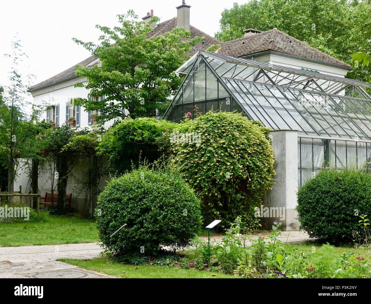 Greenhouse attached to building located in the middle of Bercy Park, Paris, France - Stock Image