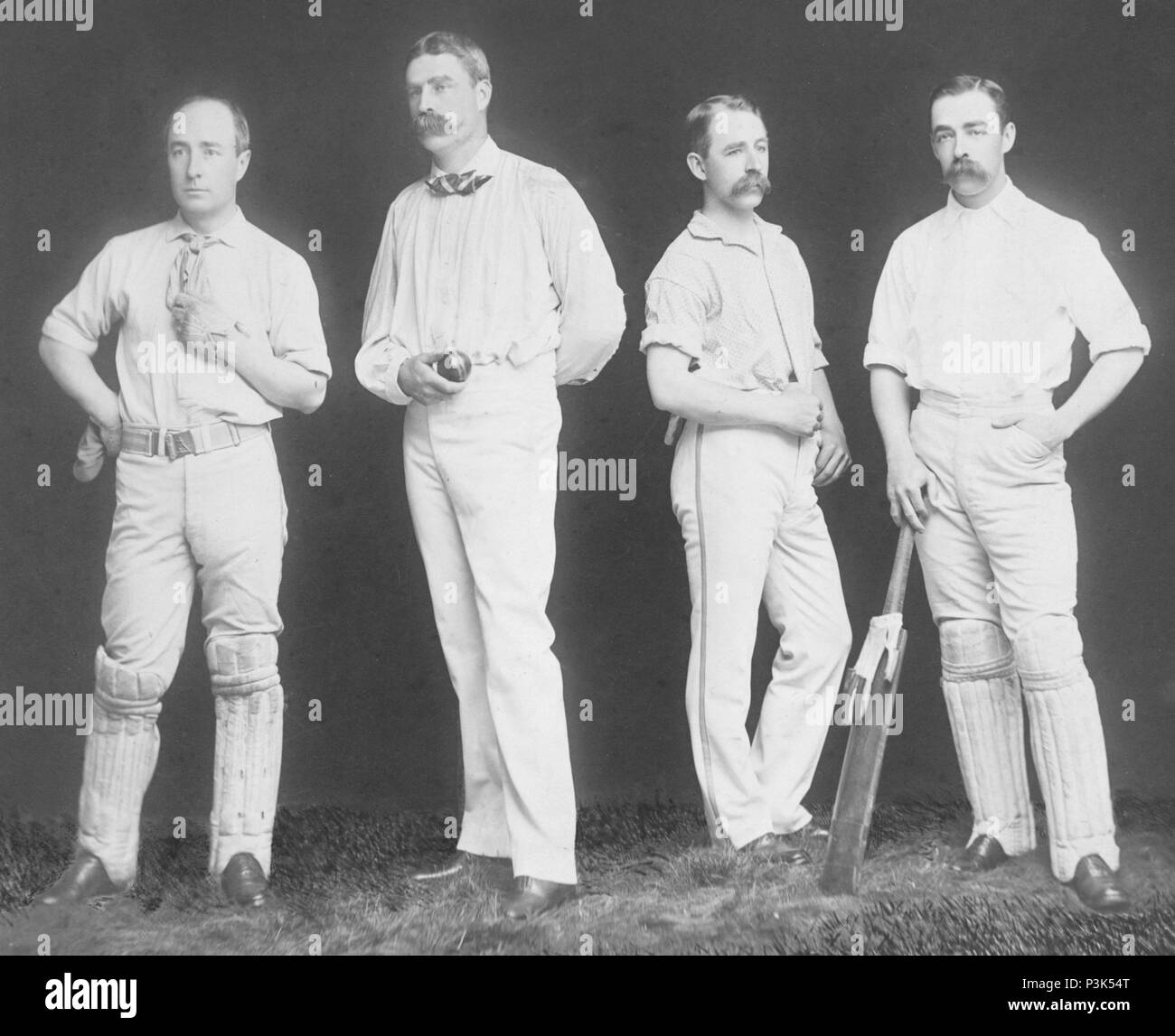 Cricket, four cricketers pose, English Cricket - Stock Image