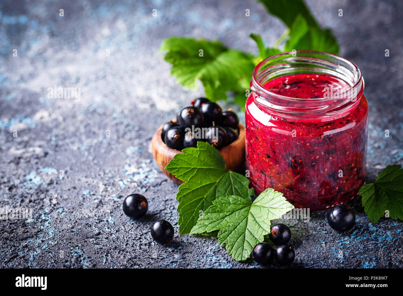 Black currant jam in jar - Stock Image