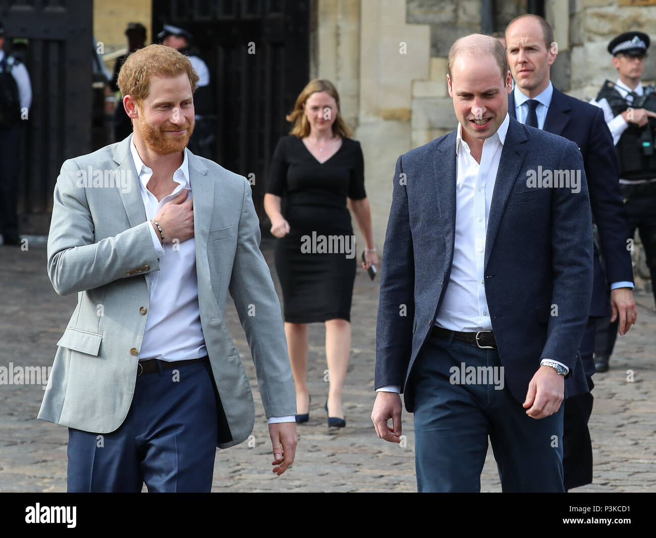Prince Harry and Prince William greet the crowds outside Windsor Castle on the evening before Prince Harry's wedding to Meghan Markle  Featuring: Prince Harry, Prince William Where: Windsor, United Kingdom When: 18 May 2018 Credit: John Rainford/WENN - Stock Image