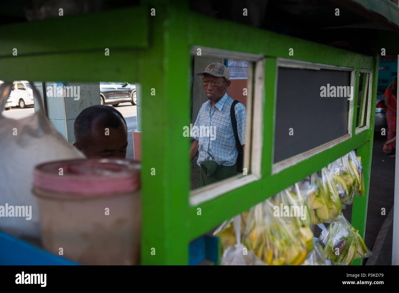 Yangon, Myanmar, reflection of a passerby - Stock Image