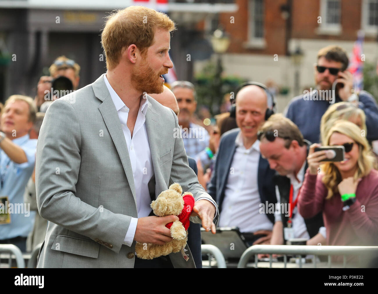 Prince Harry and Prince William greet the crowds outside Windsor Castle on the evening before Prince Harry's wedding to Meghan Markle  Featuring: Prince Harry Where: Windsor, United Kingdom When: 18 May 2018 Credit: John Rainford/WENN - Stock Image