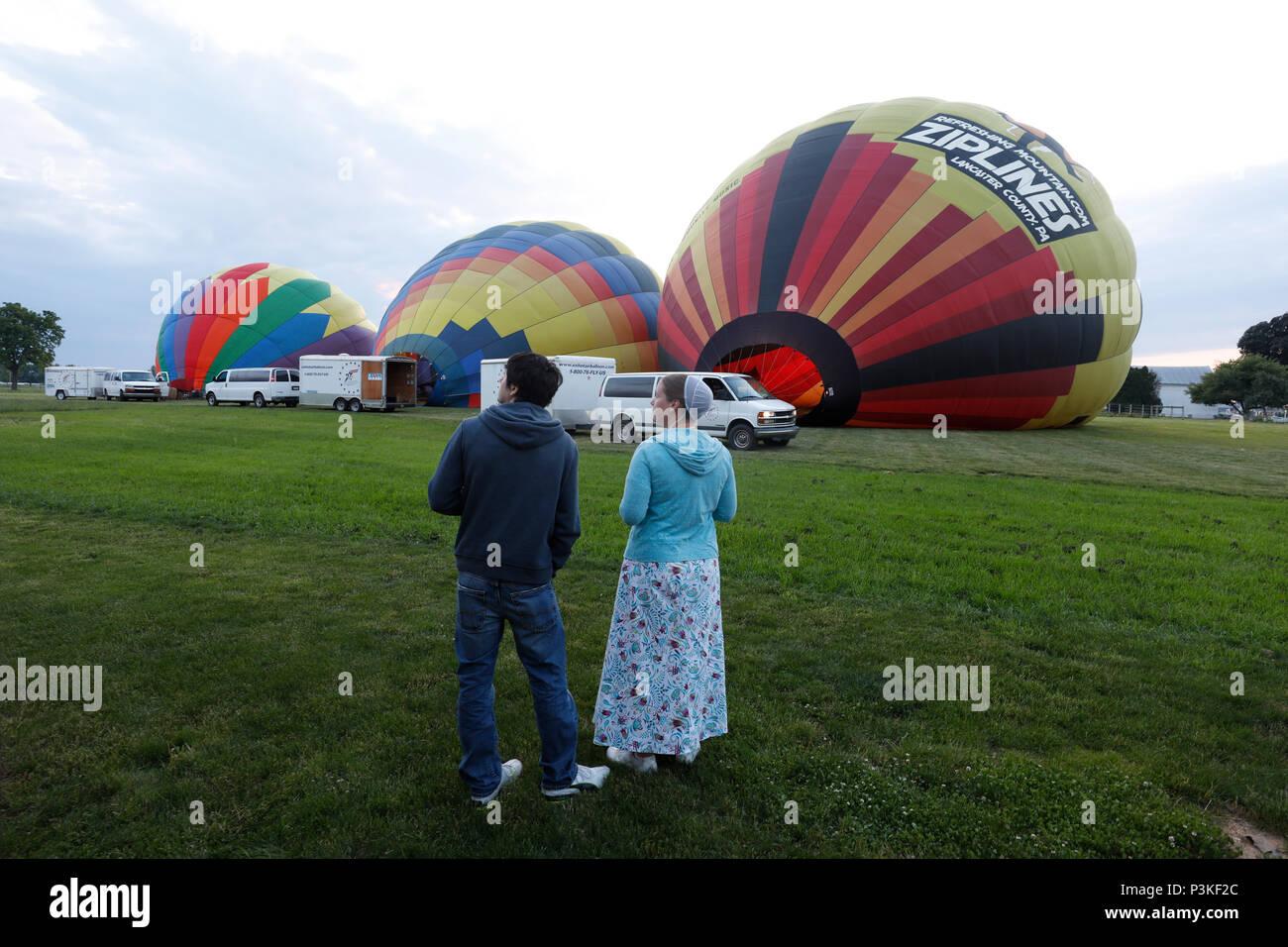Amish couple watching hot air balloons Lancaster County, Pennsylvania, USA Stock Photo